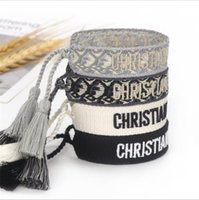 調節可能な編組リストバンドブレスレットバングルフレンドリーラッキースレッドポリエステルチャームブレスレット女性男性刺繍タッセルビンテージカップルジュエリーギフト