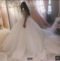2021 attractive wholesale white tulle ball gown wedding dresses heavily beading sparkly princess puffy bride dress hollow back sexy court train bridal gowns