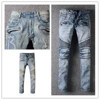 20ss estilo cassic moda jeans jeans de alta calidad color azul flaco ajustado empalmado pastillos rasgados de alta calle destruidos arruga arrodgla motocicleta motocicleta biker denim jean w28 w42