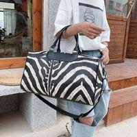 Design handbag New black and white strip fashion short distance travel portable sports large capacity luggage bag HKEY