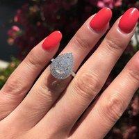 サイズ6-10見事な高級ジュエリーシルバードロップウォーターホワイトトパーズCZダイヤモンド宝石パーティー女性のウェディングブライダルリングギフト