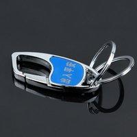 Le porte-clés de voiture en métal masculin peut être un marquage au laser lettrage publicitaire des souvenirs de marketing
