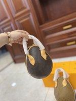 Oeufs d'oeufs de dinosaure Envoi Sac Souriant Sac d'emballage au printemps des spectacles que les lettres d'influence ovale sont des détails sur le bord de cuir d'attache et une mini-bandeau de la chaîne ..
