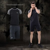 Pro Tracksuits Men's fitness 2-piece quick drying tights gym short sleeve sportswear set running training suit men