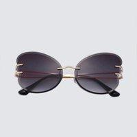 Großhandel Randlose exquisite neutrale Mode Sonnenbrille Metall Antriebsgläser C-förmige dekorative Designer UV400 Schmetterlingsflügellinse