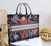 2021 Nuevo mejor bolsa de compras bolsos bolsos bolsas de moda diseñador unisex lienzo bolso de hombro negro tejido bolsa de compras sin envío 633389786