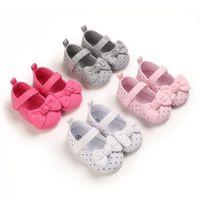 أول مشوا أحذية أطفال مولود بنين بنات دوت bowknot المضادة للانزلاق لينة وحيد طفل لطيف طفل
