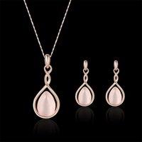 Juego de pendientes de Newne Cklace para joyería Boho Llegada Pink OPAL Collar Pendientes y anillo Juego de joyas Natural Gem Stone Gota de agua Mujeres 704 Q2