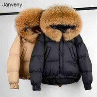 Janveny Огромный енотный мех с капюшоном зимний пух пульсина на пальто женщины 90% белая утка куртка короткие толстые теплые женские паркиувальники 210901
