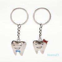 2 piezas Dientes de dibujos animados llaveros Modelo de dientes Forma Modelo Llavero Clínica Dental Regalo Dentista Decoración Decoración Cara de acero inoxidable Trendy