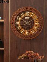 중국어 스타일 단단한 나무 벽 시계 거실 크리 에이 티브 아트 침묵 손으로 새겨진 중공 럭셔리 시계 홈 장식 독특한 선물
