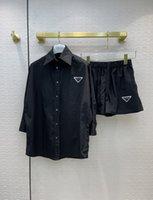 2021 kadın iki parçalı pantolon yaka boyun uzun kollu baskı ceket ve şort markası aynı stil 2 parça setleri 0602-2