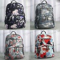 デザイナー若い男の子女の子バッグ大容量メンズとレディーススクールバックパックファッションナイロンキャンバス素材ハロー染色花装飾ムイバッグビッグサイズ40#i6de#