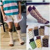 Chicos lindos niñas calcetines de algodón otoño invierno niños letras impresas rodilla-altas en calcetines de tubo calcetines de niños 6 colores