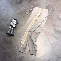 Reflexivo vintage alta qualidade ess pants calças homens e mulheres calças de moletom tendências de moda desenhador calça letra bordado high street