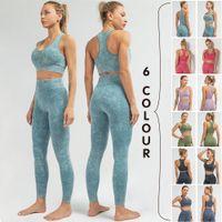 Set de alta calidad de yoga transparente QRWR Women Fitness Sportswear Elastic Sports Sujetadores y sin costuras Leggings de cintura alta de la gimnasia