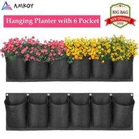 Amkoy pendurado jardim flor potenciômetro plástica 6 bolsos layout impermeável parede vertical suspensão plantando macacos parede exterior 210401