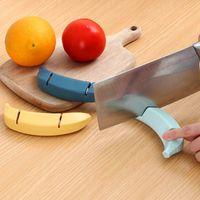 Affilatura in acciaio inox Affilatura della pietra Affilatrice Forma della banana Decorare antiscivolo Coltello da cucina Accessorio La cucina RRD7518