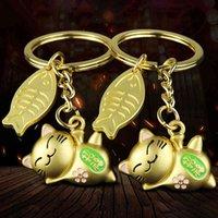 Bel signore sorridenti e pesci portachiavi in metallo buona fortuna benedizione portachiavi ricchi ricchi portachiavi per gatto