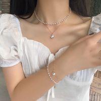 Moda coreano imitación perla collares collares pulsera simple dulce y encantador cadenas de cuentas doble corta cadena de cadena de cadena de temperamento regalo de joyería de niña