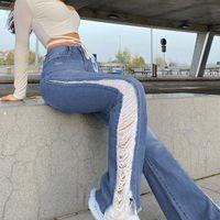 90s esthétique taille basse taille slim jeans sexy Femmes Vintage Side Hole Flare Pantalons longs Streetwear Y2K Deneur en denim en détresse 2021 Femmes
