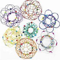 USA Maszyna wielokrotne zmiany Mandala Party Favor Kosz Kosz Magiczny Pierścień Przepływ Fidget Zabawki Handmade Kolorowe Żelazo Pętle Wytwarty Stresowy Reliever Relief Gra