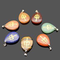 Ключевые слова на русском: натуральный камень в форме воды мода шарм кулон ожерелье выгравированные индуистские шивы Trident Reiki символ висячий аксессуар целебный кристалл религии ювелирные изделия