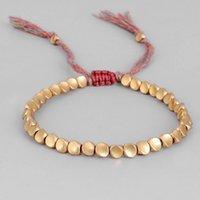 Hilo budista tibetano hecho a mano Hilo de algodón abrazado Lucky Pulsera Cobre Beads tallado Amuleto Charm Pulsera para hombres Mujeres Pareja