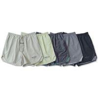2021 Mode Summer Etats-Unis Laser Reflective Nylon Shorts colorés Matcha Green Femmes Hommes 6ème Pantalon de jogging moyen High Street Street