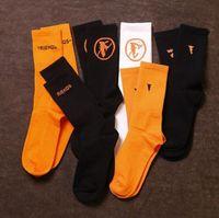 Calze di moda 3 paia arancione nero grande lettera europea americana high street da uomo e calzini da skateboard