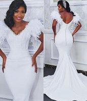 2021 Plus Size Arabic Aso Ebi Feather Crystals Sexy Wedding Dresses Deep V-neck Backless Bridal Mermaid