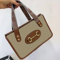 Designer kosmetisk väska kvinnor handväskor äkta läder kanfas material handväska högkvalitativa brev dekoration kvinna söt unik present säck
