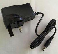 Ausgang 12V1A 50 / 60Hz AC / DC-Adaptereingang AC 100V-240V-Wandler 1000mA Netzteil Ukplug CE-kompatible Kameramelampe CCTV-Objektiv