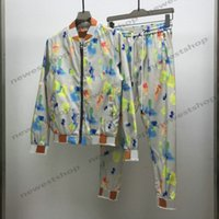 21ss Designer de moda Vestuário Mens Cor Graffiti Imprimir Tracksuit Paris Classical Letra Imprimir Jaqueta Outwear Suéter Suit Terno Patchwork Sportwear Calças
