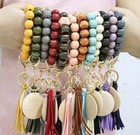 Cross-border personality bracelet craft carved wood beads keychain blank disc tassel key ring pendant multi-color optional