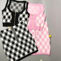325 2021 весенний летний бренд такой же стиль два штуки наборы короткие юбки с круглым вырезом без рукавов империя розовый черный плед мода женская одежда Сюй