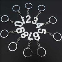 Porte-clés numériques numériques Pendentifs 0 1 2 3 4 5 6 7 8 9 Porte-clés en acier inoxydable réutilisé 10 pièces assorties chiffres arabes H0915