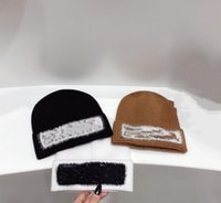 2021 Neueste Luxusmarke Mode Designer Beanie Winterkappen Hüte Frauen Männer Mützen mit echtem Waschbär Pelz Pompoms Warme Mädchen Cap Snapback Pompon Top Qualität Sonne Viso