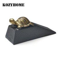 Parada de la puerta de la tortuga dorada de hierro fundido, tapa de metal en forma de cuña que no resbala los amortiguadores negros para el piso de la oficina se cierran los cierres