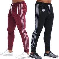 Pantalon de jogging noir à rayures pour hommes Nouveaux hommes Fashion Fashion Fitness Formation Sports Pantalons Ziplan Poche grande taille M-2XL
