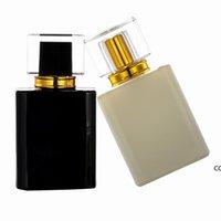 NewWholesale 50 unids Toma de perfume cuadrado de alta gama Botella de atomizador 50 ml de vidrio blanco y negro Botellas de aerosol Portátil DHD8875