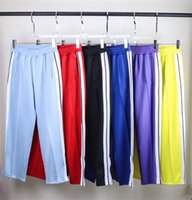 Мужские женские штаны спортивные брюки дизайнеры дизайнеров трексуитов костюмы свободные пальто куртки толстовки с толщами толстовки с толщинами Друдистые брюки Rainbow Drawstring молния брюки повседневная спортивная одежда