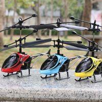مصغرة rc بدون طيار هليكوبتر التحصين 2 قناة الإلكترونية مضحك تعليق طائرات التحكم عن بعد كوادكوبتر بدون طيار الاطفال هدايا
