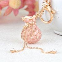 Bolsa chinesa de vento decorada com gato-olho de pedra de pedra de diamante de diamante de metal metal chave de pingente da senhora da senhora