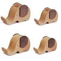Teléfono celular Soportes Soportes LX0B Creativo Diseñado Madera Made Elephant Stay Pop Holder Taza de escritorio Organizador Caja de madera linda para lápiz Contai