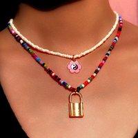 Collares colgantes 2 unids / set Gold Lock Yin Yang Flor Collar con cuentas para mujer colorido acrílico semilla bohemia joyería bohemia 2021