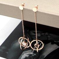 DANNGLE Chandelier Fashion Boule creuse suspendue Numérums romains Noir et blanc Coquille double face Boucles d'oreilles en or rose pour femmes bijoux entiers