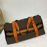 2021 Senhoras PU couro Duffel Bag Mens Saco de viagem Designer portátil de alta qualidade homens handbag super grande capacidade mensageiro sacolas pacotes 55cm