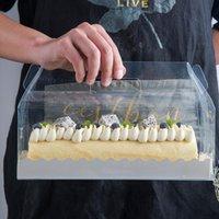 Boîte d'emballage de rouleau de gâteau transparent avec poignée de gâteau de gâteau en plastique claire en plastique dégagée cuisson à pâte à rouleau suisse