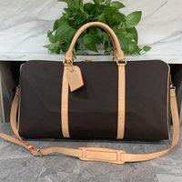 Mode de luxe Hommes Femmes Sac de voyage Sac Duffle Sac, Marque Designer Sacs à main Bagages Sacs Sport de grande capacité 55cm avec serrure